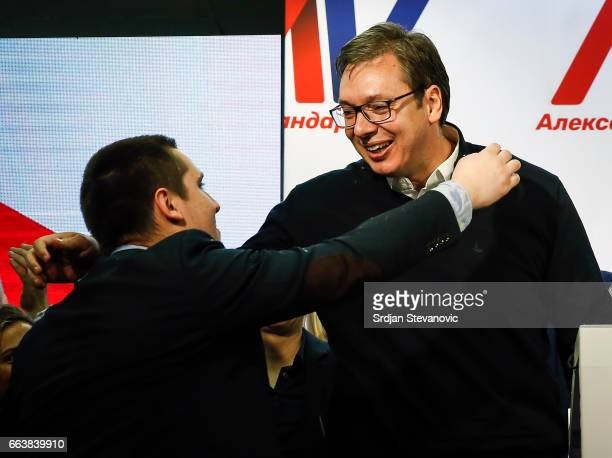 Serbian Presidentelect Aleksandar Vucic celebrates with his son Danilo after declaring a victory on April 2 2017 in Belgrade Serbia According to the...
