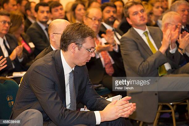 Serbian Prime MInister Aleksandar Vucic applauds a speech at the Serbia Investment Day at Central Hall Westminster on October 29 2014 in London...