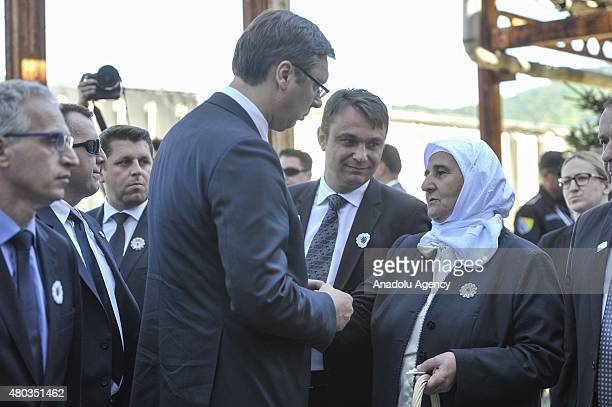 Serbian Prime Minister Aleksandar Vucic is greeted by Munira Subasic the president of the Mothers of Srebrenica Association as he arrives at Potocari...