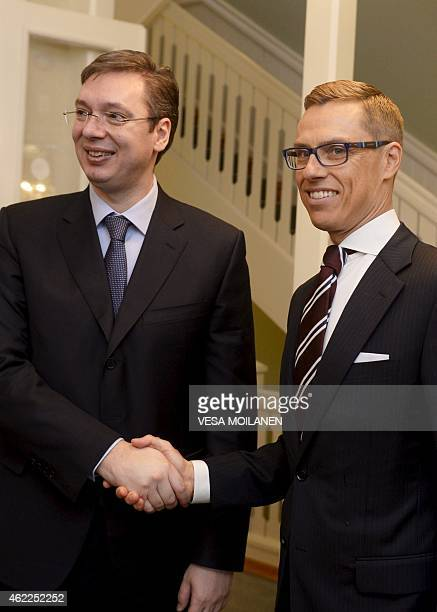Serbian Prime Minister Aleksandar Vucic shakes hands with his Finnish counterpart Alexander Stubb as they meet at the Prime Minister's official...