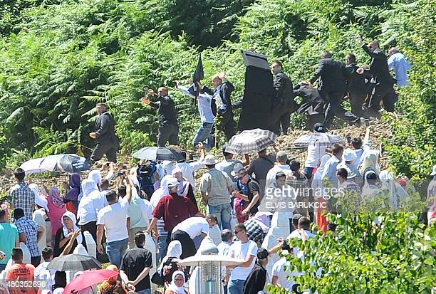 Serbian Prime Minister Alexandar Vucic and his delegation escorted by security forces leave the Potocari Memorial Cemetery on July 11 2015 near...