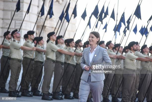 Serbian Prime Minister Ana Brnabic walks past the honour guard as he arrives at the Western Balkans summit in Piazza Unita d'Italia in Trieste Italy...
