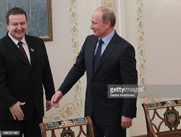 Serbian Prime Minister Ivica Dacic greets Russian President Vladimir Putin during a meeting on April 10 2013 in Moscow Russia The two leaders met to...