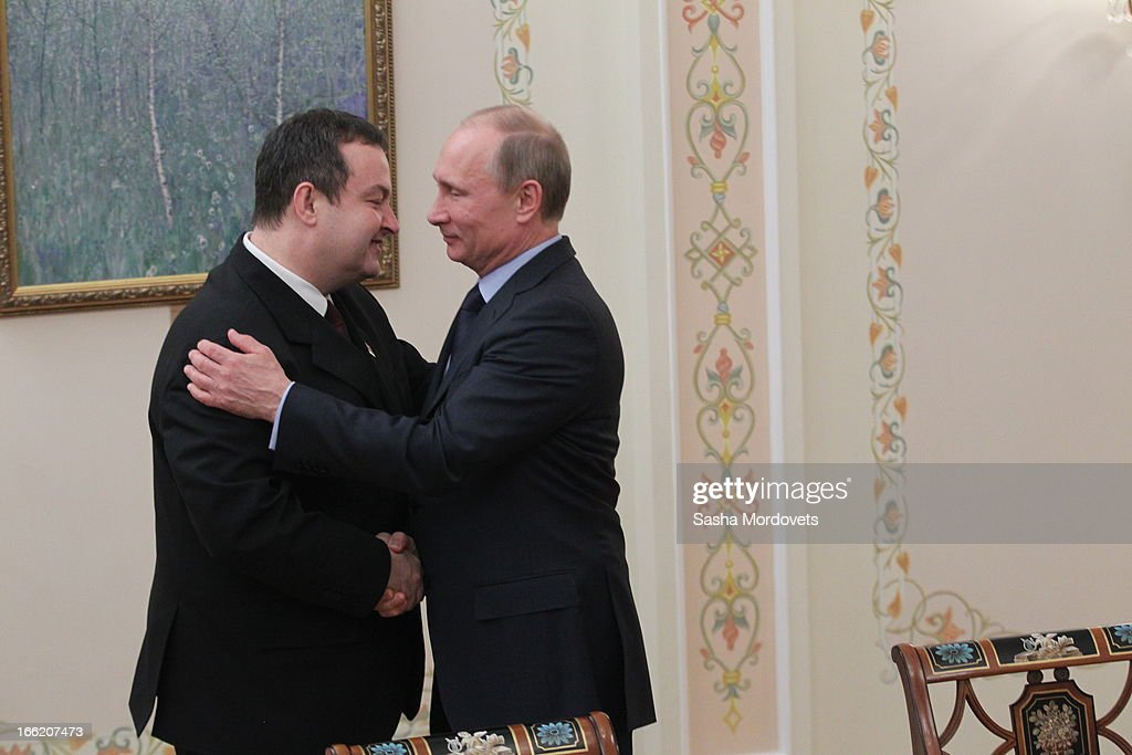 Serbian Prime Minister <a gi-track='captionPersonalityLinkClicked' href=/galleries/search?phrase=Ivica+Dacic&family=editorial&specificpeople=5427949 ng-click='$event.stopPropagation()'>Ivica Dacic</a> (L) greets Russian President Vladimir Putin (R) during a meeting on April 10, 2013 in Moscow, Russia. The two leaders met to discuss issues related to trade, energy and humanitarian issues, amongst others.