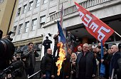 Serbian Radical Party leader Vojislav Seselj whose war crimes verdict is due on March 31 sets EU and NATO flags on fire in front of the courthouse in...