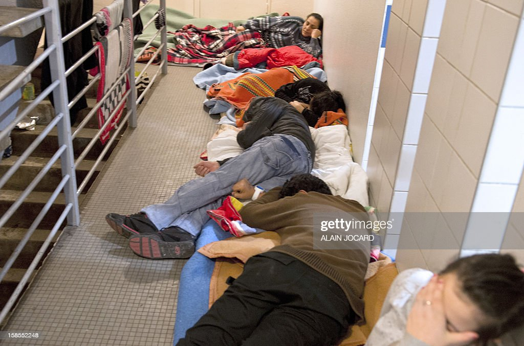 A Serbian refugees family sleeps in a building foyer on December 18, 2012, in Tours, central France.