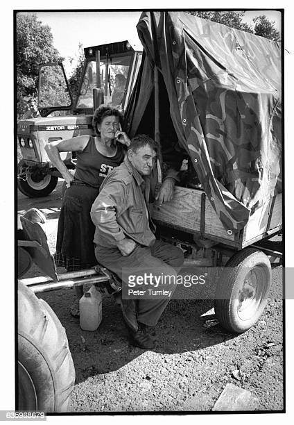 Serbian refugees lean against their camouflaged cart piled high with belongings at the Serbian border After the fall of Communism in 198990...