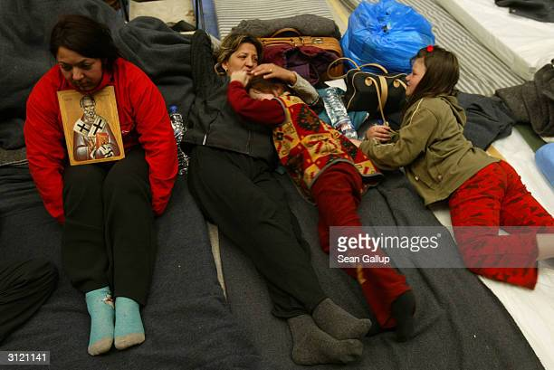 Serbian refugees Stanka Todorovic rests with her sister Jasmina her daughter Milica Milosovic and relative Senka Stefanovic in a makeshift shelter...
