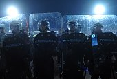 Serbian riot police officers stand guard during the EURO 2016 group I qualifying football match Serbia vs Albania in Belgrade on October 14 2014 AFP...