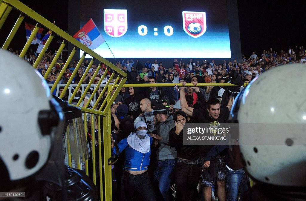 Serbian riot police scuffles with angry Serbian supporters during the EURO 2016 group I football match between Serbia and Albania in Belgrade on...