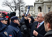Serbian riot police stand guard outside the presidency building as Radical Party supporters protest against Serbian President Tomislav Nikolic in...