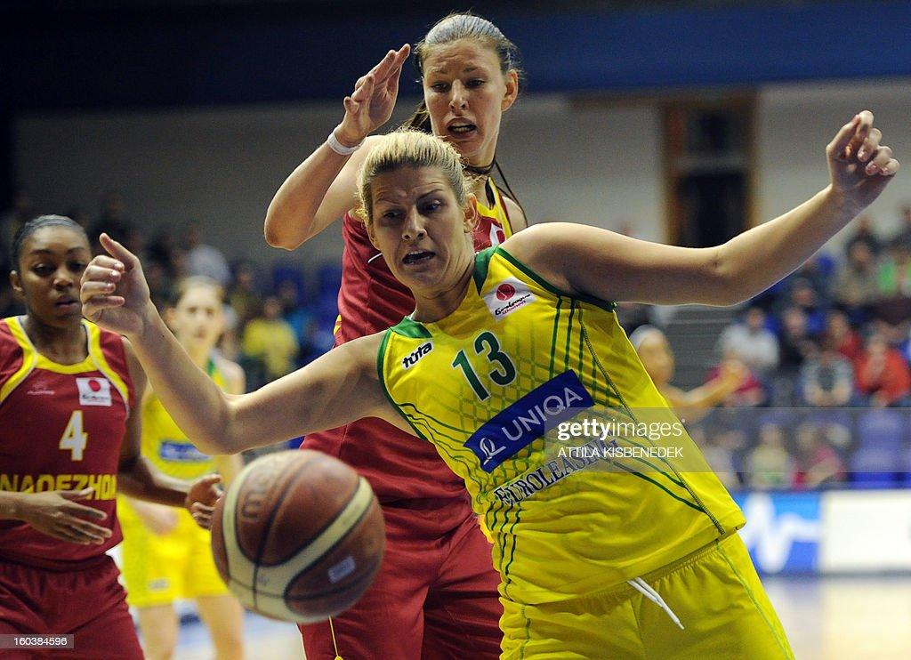 Serbian Sara Krnjic (R) of Hungarian UE Sopron fights for the ball Tamane Zane of Russian Nadezhda Orenburgon January 30, 2013 during their basketball EuroLeague match in Sopron, Hungary.