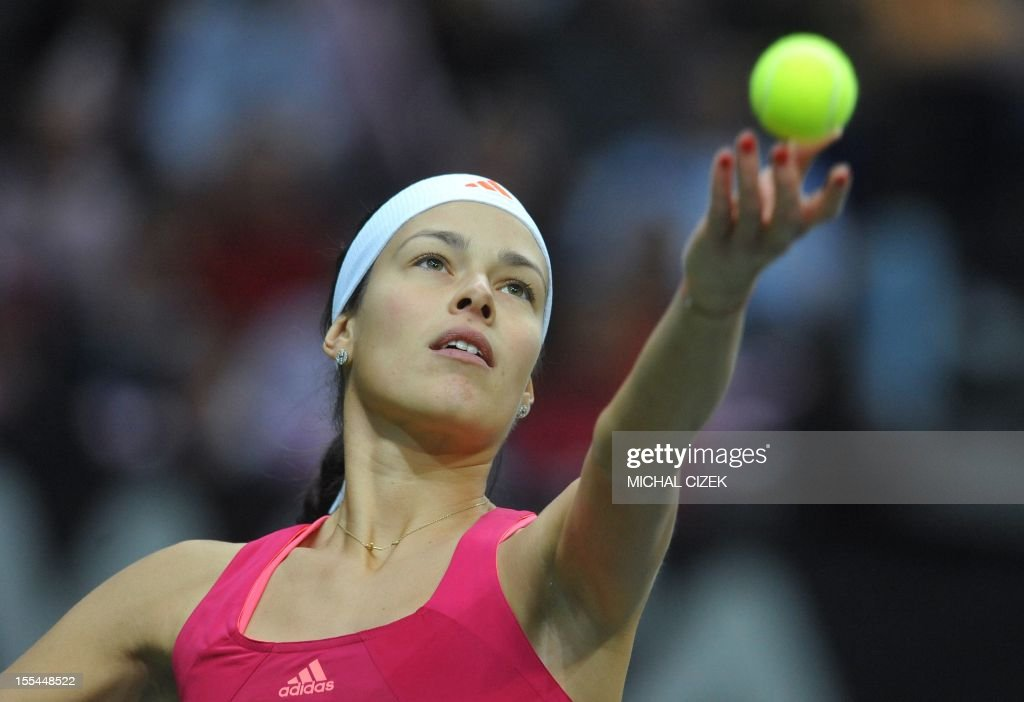 serbian-tennis-player-ana-ivanovic-eyes-the-ball-to-hit-return-during-picture-id155448522