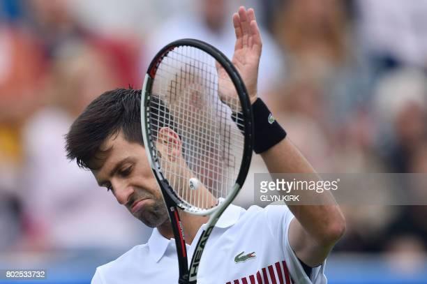 TOPSHOT Serbian tennis player and world number four Novak Djokovic gestures during his men's singles round two tennis match against Canadian Vasek...