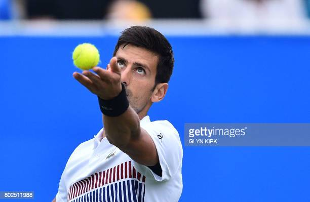 Serbian tennis player and world number four Novak Djokovic plays a shot during his men's singles round two tennis match against Canadian Vasek...