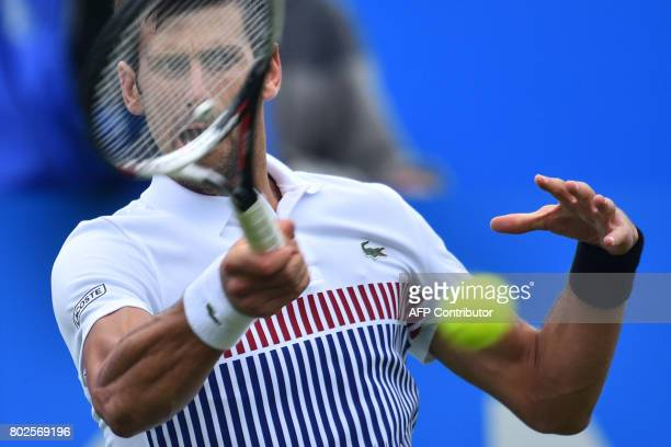 TOPSHOT Serbian tennis player and world number four Novak Djokovic plays a shot during his men's singles round two tennis match against Canadian...