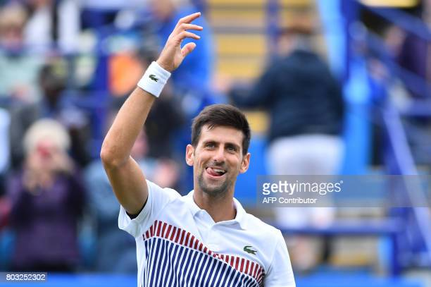 TOPSHOT Serbian tennis player and world number four Novak Djokovic reacts after winning against Donald Young of the US during their men's singles...