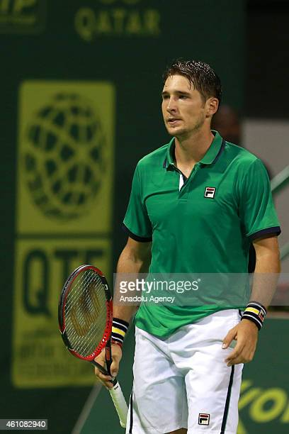 Serbian tennis player Dusan Lajovic gestures during his tennis match with Novak Djokovic of Serbia in the Qatar's ExxonMobil Open at the Khalifa...