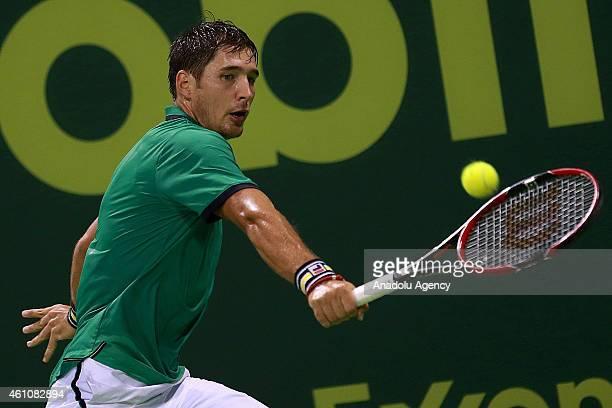 Serbian tennis player Dusan Lajovic returns the ball to Novak Djokovic of Serbia during their tennis match in the Qatar's ExxonMobil Open at the...