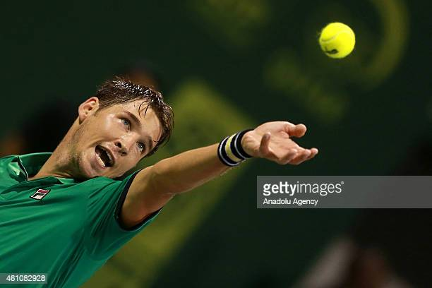 Serbian tennis player Dusan Lajovic serves the ball to Novak Djokovic of Serbia during their tennis match in the Qatar's ExxonMobil Open at the...