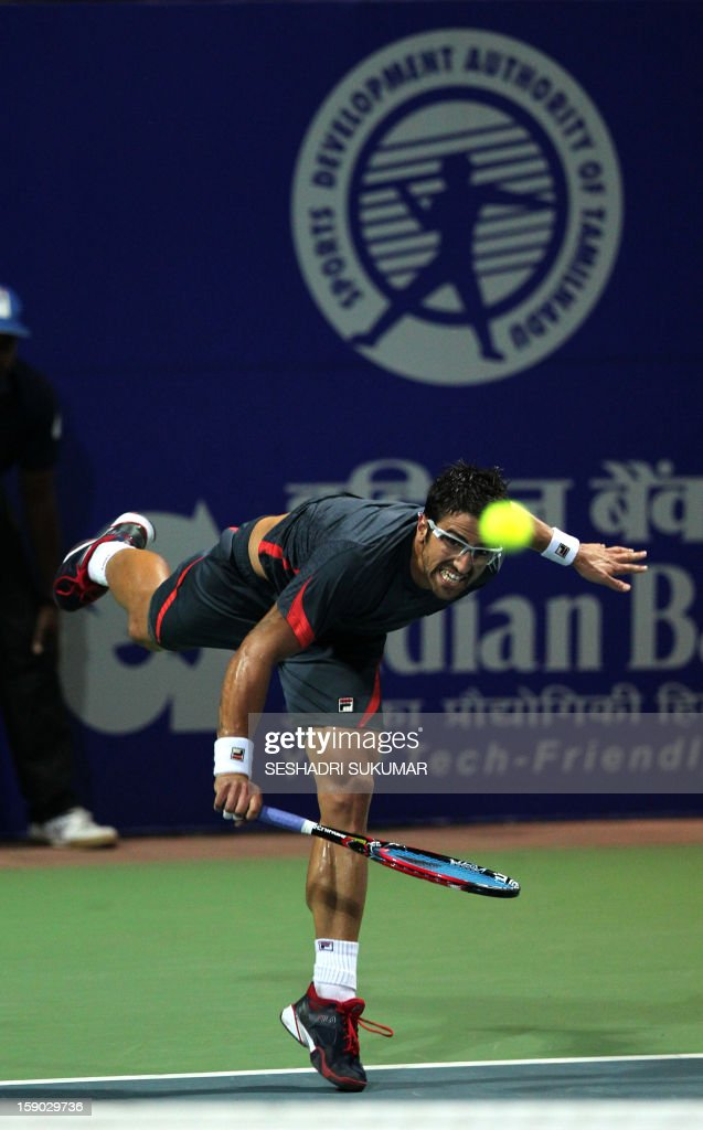 Serbian tennis player Janko Tipsarevic plays a return to Spanish opponent Roberto Bautista-Agut during their final match at the ATP Chennai Open 2013 in Chennai on January 6, 2013. AFP PHOTO/Seshadri SUKUMAR