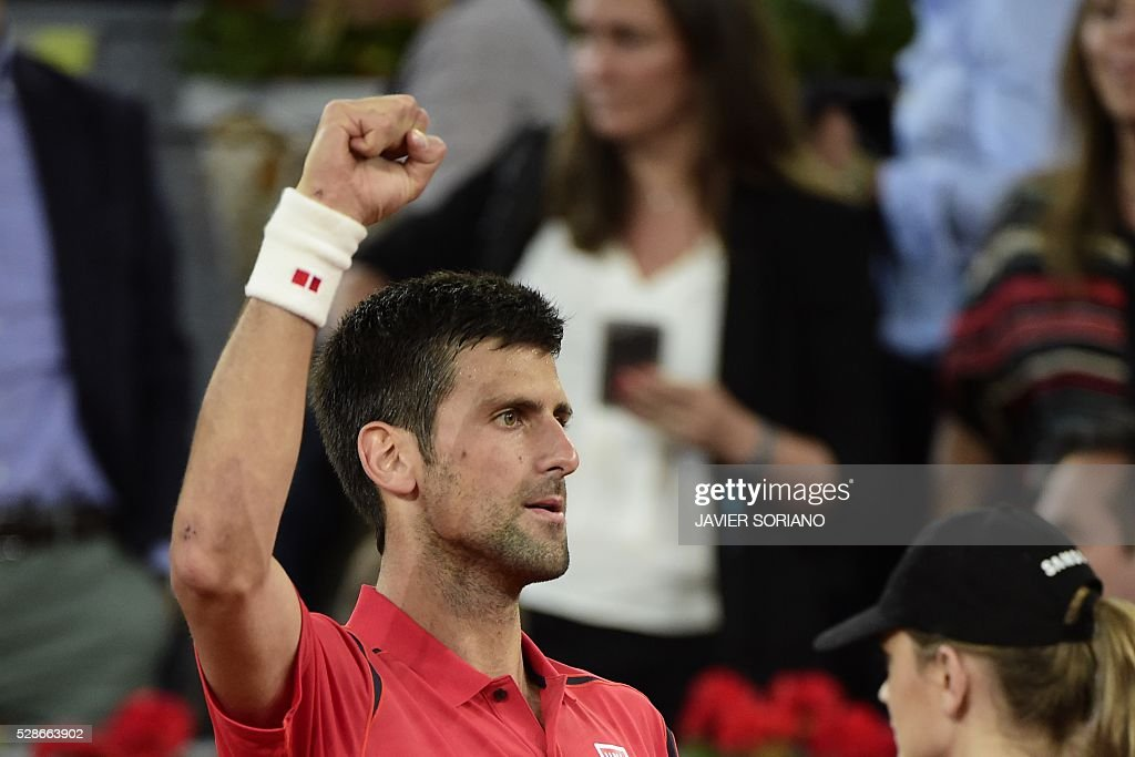 Serbian tennis player Novak Djokovic celebrates after defeating Canadian tennis player Milos Raonik during the Madrid Open tournament at the Caja Magica (Magic Box) sports complex in Madrid on May 6, 2016. / AFP / JAVIER