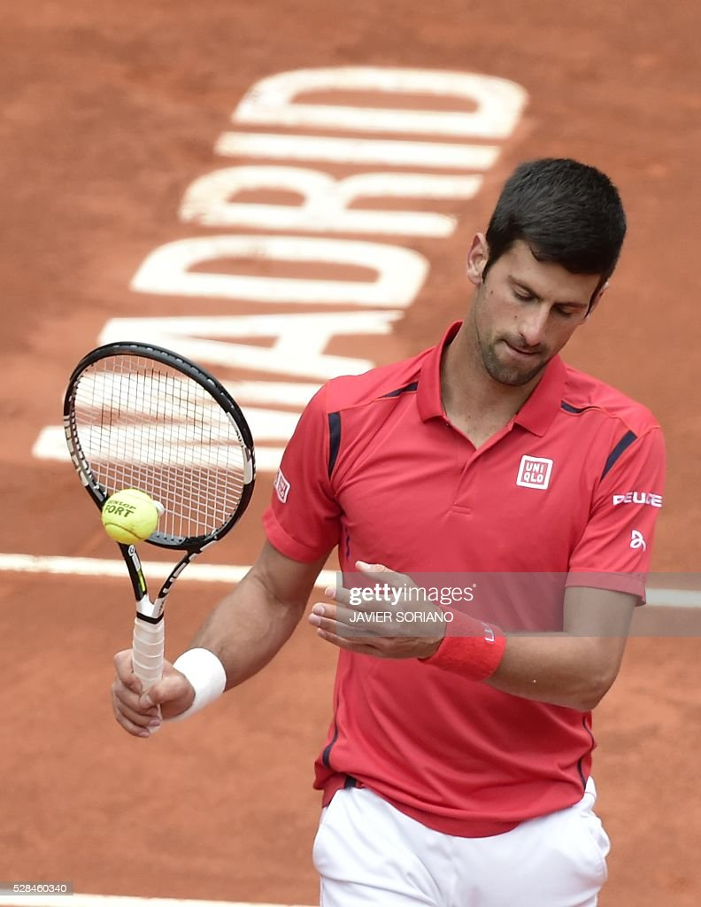 Serbian tennis player Novak Djokovic gestures during his match against Spanish tennis player Roberto Bautista during the Madrid Open tournament at the Caja Magica (Magic Box) sports complex in Madrid on May 5, 2016. / AFP / JAVIER