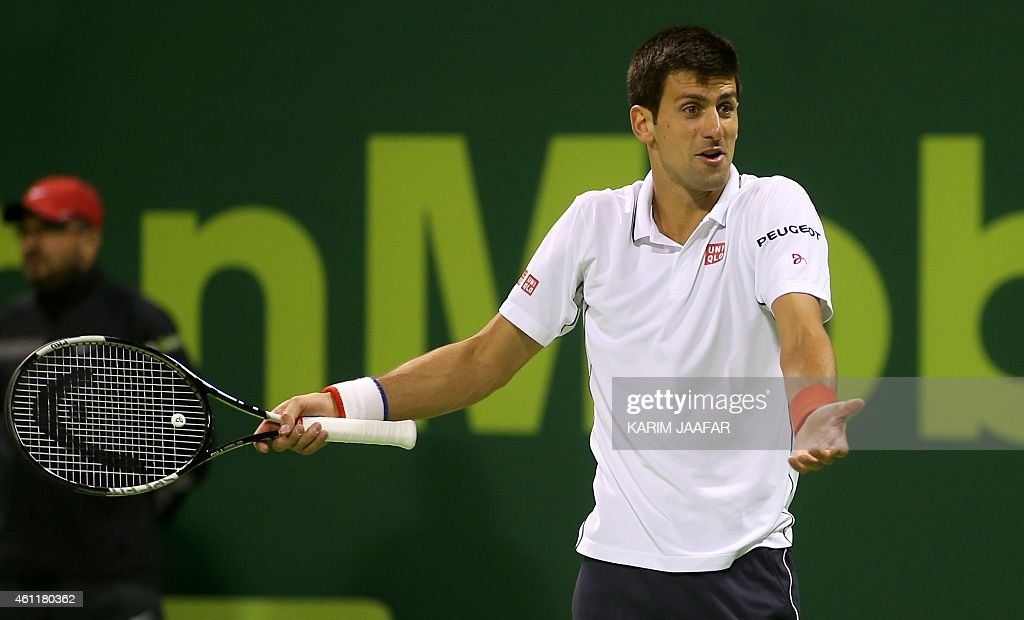 Serbian tennis player Novak Djokovic reacts during the quarterfinals tennis match against Ivo Karlovic of Croatia in Qatar's ExxonMobil Open in Doha...