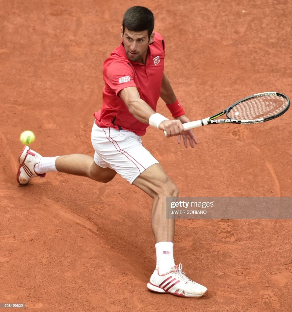Serbian tennis player Novak Djokovic returns a ball to Spanish tennis player Roberto Bautista during the Madrid Open tournament at the Caja Magica (Magic Box) sports complex in Madrid on May 5, 2016. / AFP / JAVIER