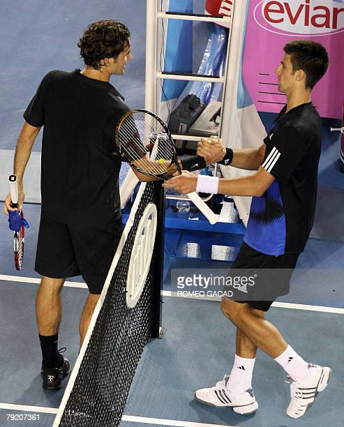 Serbian tennis player Novak Djokovic shakes hands with Swiss opponent Roger Federer after victory in his mens semifinal singles match at the...