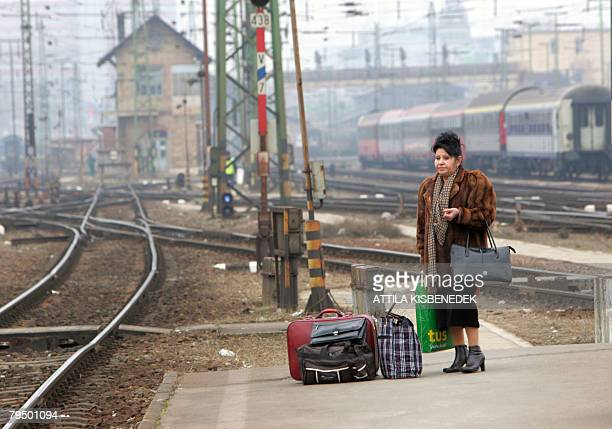 A Serbian traveller waits for help on the platform of the main Hungarian railway station of Keleti in Budapest February 4 as Hungarian rail workers...