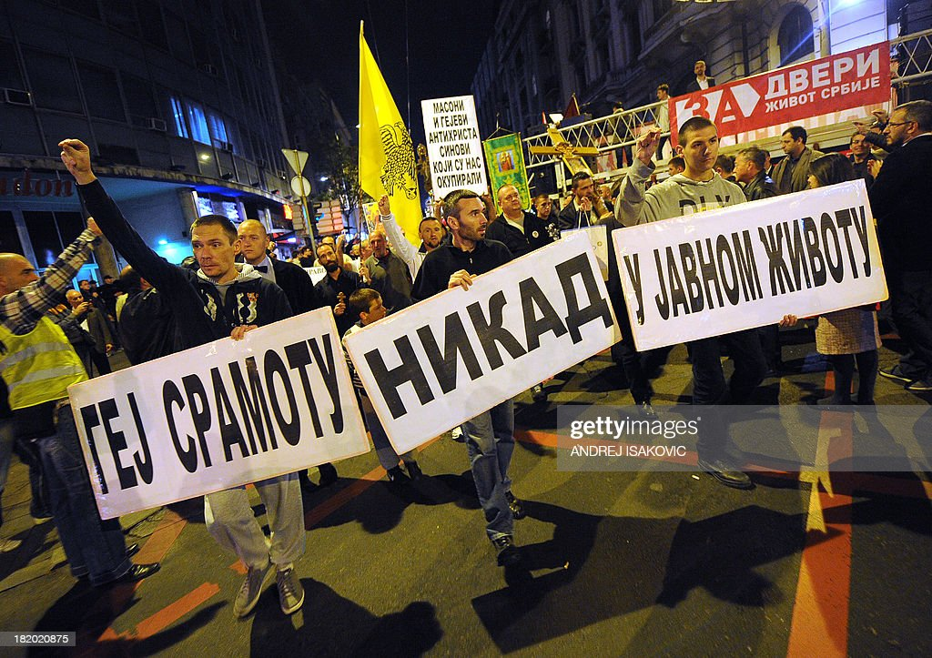 Serbian ultra nationalists march during an anti-gay protest in Belgrade on September 27, 2013. Serbia's authorities on Friday banned for the third consecutive year Gay Pride, saying it was too high security risk to allow it. Several far-right organisations announced their intention to protest tomorrow at the time and the place where the parade is supposed to take place. Banner reads 'No gay shame in public life'.