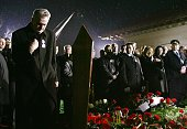 Serbian ultranationalist leader Tomislav Nikolic prays in front of the grave of the former Yugoslav leader Slobodan Milosevic during his funeral at...