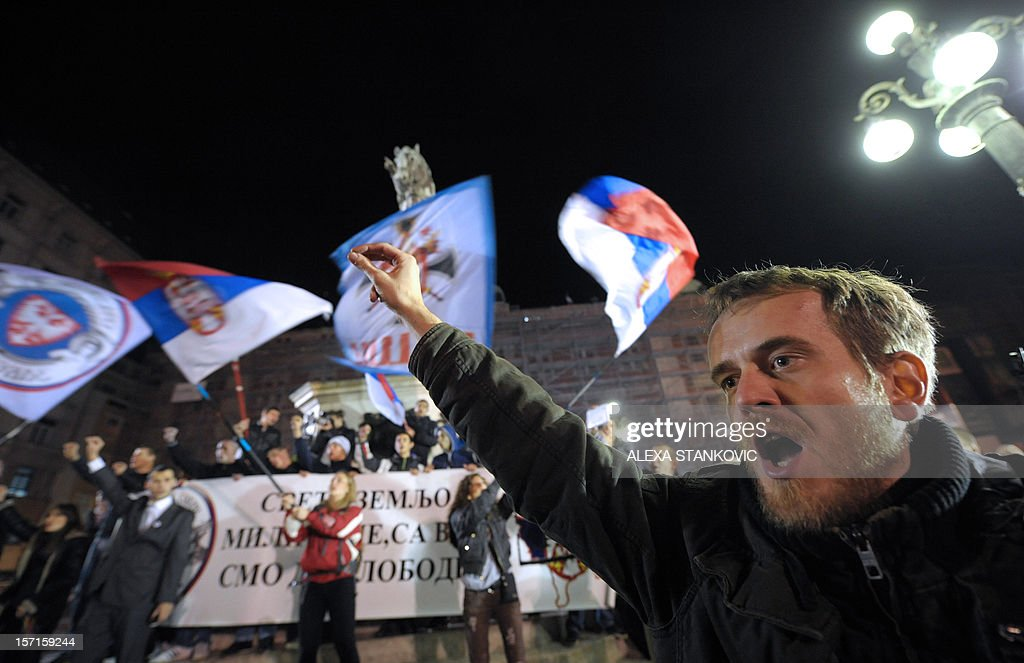 A Serbian ultra-nationalist shouts slogans during a rally to protest after a UN court cleared Kosovo's former prime minister Ramush Haradinaj of war crimes committed during the 1998-1999 conflict, in Belgrade on November 29, 2012. A UN war crimes court on November 29, cleared Haradinaj of murder and torture during the 1990s war of independence, enraging Belgrade with the second such acquittal in two weeks. The Hague-based International Criminal Tribunal for the former Yugoslavia (ICTY) cleared the former military commander and two of his former guerrilla comrades after a case that lasted seven years. AFP PHOTO / ALEXA STANKOVIC
