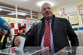 Serbian ultranationalist Vojislav Seselj leader of the Serbian Radical Party recently acquitted by UN judges of war crimes charges casts his vote at...