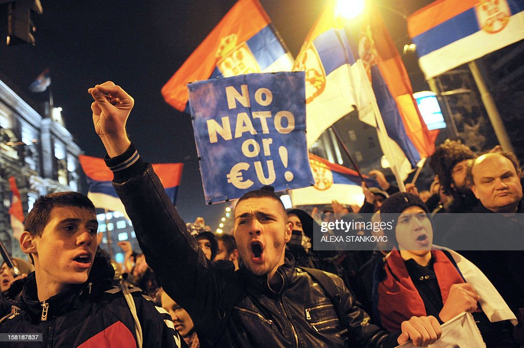 Serbian ultra-nationalists shout slogans in Belgrade on December 10, 2012, during a protest against the opening of jointly operated crossing points between Serbia and Kosovo. The first two disputed crossings on the flashpoint border between Serbia and Kosovo opened on December 10 following a EU-mediated deal on joint border management between Pristina and Belgrade which has still been rejecting unilaterally declared independence of its former province.