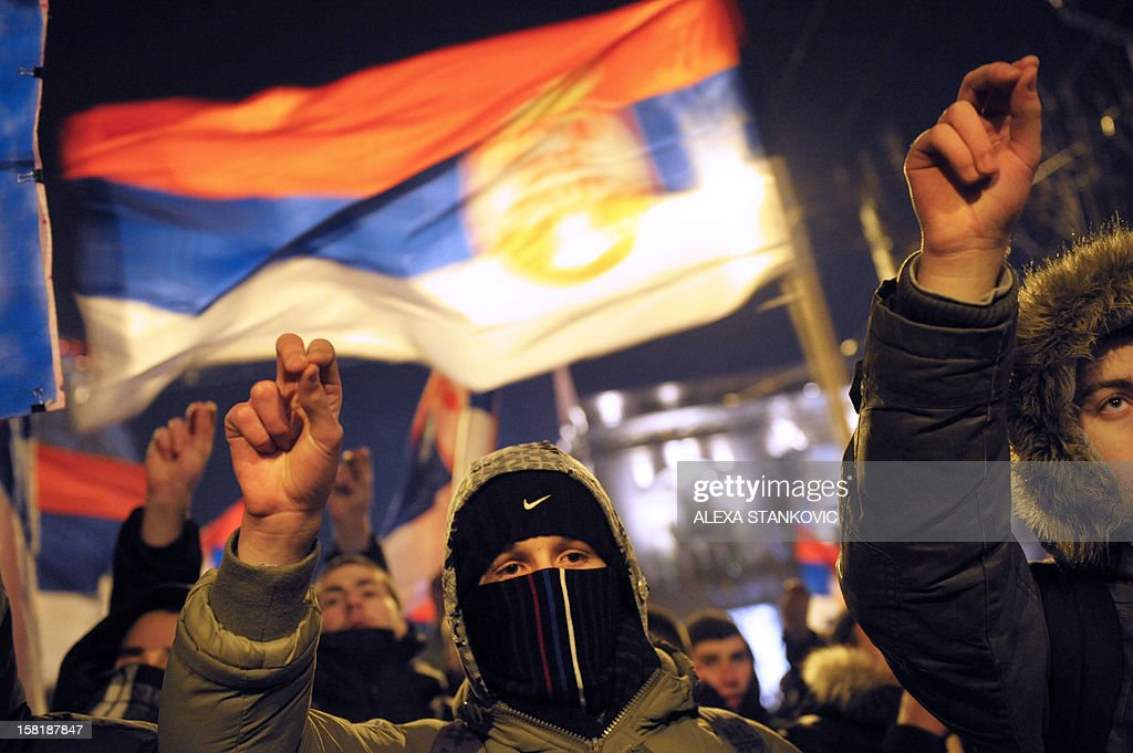 Serbian ultra-nationalists take part ina protest in Belgrade on December 10, 2012, against the opening of jointly operated crossing points between Serbia and Kosovo. The first two disputed crossings on the flashpoint border between Serbia and Kosovo opened on December 10 following a EU-mediated deal on joint border management between Pristina and Belgrade which has still been rejecting unilaterally declared independence of its former province.