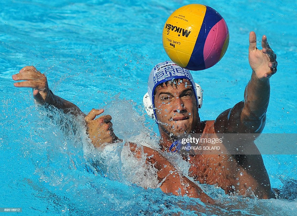 Serbian Vanja Udovicic fights for the ball with Croatian player during the waterpolo men semifinal on July 30 2009 at the FINA World Swimming...