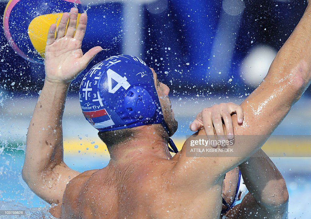 Serbian Vanja Udovicic figths for the ball with his Russian opponent in the Mladost venue swimming pool of Zagreb on September 1 2010 during their...