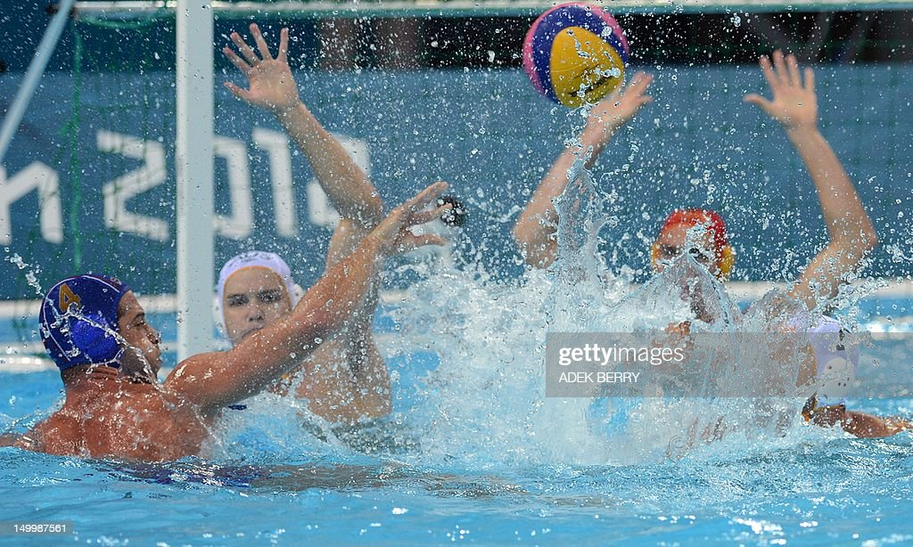 Serbian Vanja Udovicic launches the ball as Australia's goal keeper Joel Dennerly tries to block during their Men's water polo Quarterfinal round...