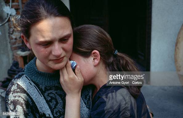 A Serbian woman comforts a young girl after surviving an attack by the Kosovo Liberation Army during the Yugoslavian Civil War In the late 1990s the...