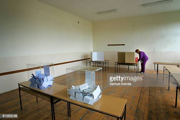 Serbian woman prepares to cast her vote in a polling station inside a school May 11 2008 in Mitrovica in northern Kosovo Serbs voted in parliamentary...