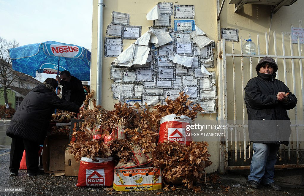 A Serbian woman sells dried oak branches, the Yule log symbol for the Orthodox Christmas eve, in Trstenik, southern Serbia, on January 6, 2013. The branches are carried into the homes and burned on Orthodox Christmas Day, which is celebrated according to the Julian calendar, on January 7, 2013.