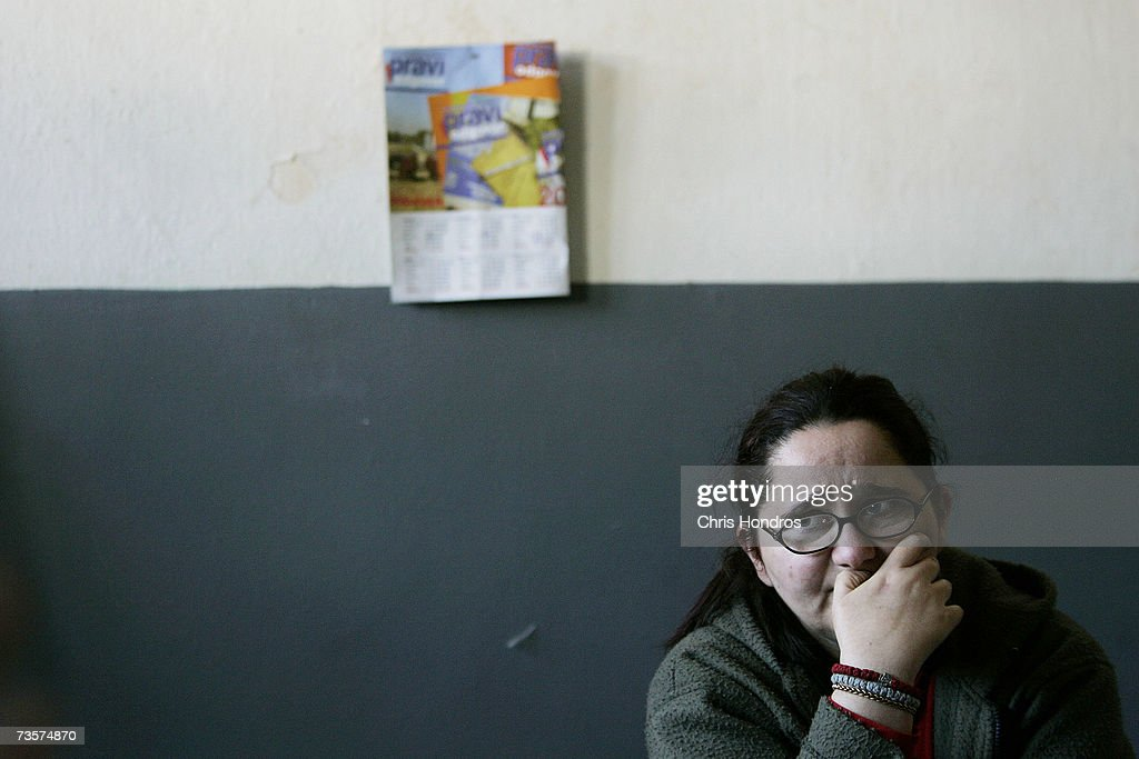 Serbian woman sits in a room of an abandoned school she's lived in for eight years with her parents, after fleeing their village in Albanian-dominated Kosovo March 14, 2007 in Mitrovica, Kosovo. Before 1999 Mitrovica was a town where Serbs and ethnic Albanians lived side-by-side. It is now is Kosovo's most glaring symbol of separation, as the two populations quickly separated themselves after the fall of the Serbian government in Kosovo and occupied opposite banks of the Ibar river. Serbs fleeing from ethnic Albanian reprisal attacks fled to Serbian northern Mitrovica in 1999, settling down in an abandoned school.