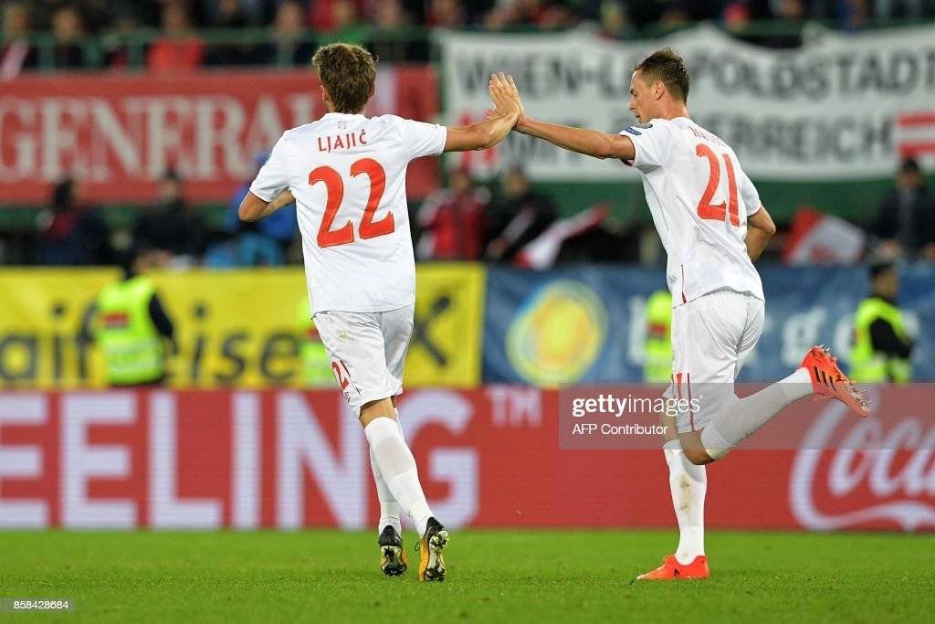 Serbia's Adem Ljacic (L) and Nemanja Matic celebrate after scoring a goal during the FIFA World Cup 2018 qualification football match between Austria and Serbia at the Ernst Happel stadium in Vienna on October 6, 2017. /