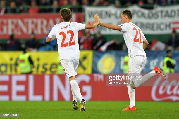 Serbia's Adem Ljacic and Nemanja Matic celebrate after scoring a goal during the FIFA World Cup 2018 qualification football match between Austria and...