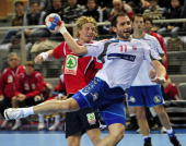 Serbia's Alem Toskic attempts to score as he vies with Norway's defence during their Group D match at the Men's Handball World Championship on...