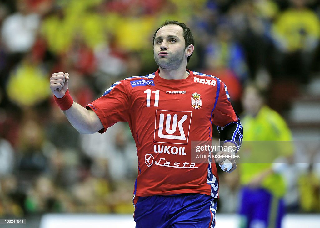 Serbia's Alem Toskic celebrates after scoring against Sweden during their 22nd Men's Handball World Championships Main Two group match at the Malmo Arena on January 22, 2011. AFP PHOTO / ATTILA KISBENEDEK