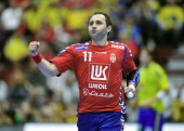 Serbia's Alem Toskic celebrates after scoring against Sweden during their 22nd Men's Handball World Championships Main Two group match at the Malmo...