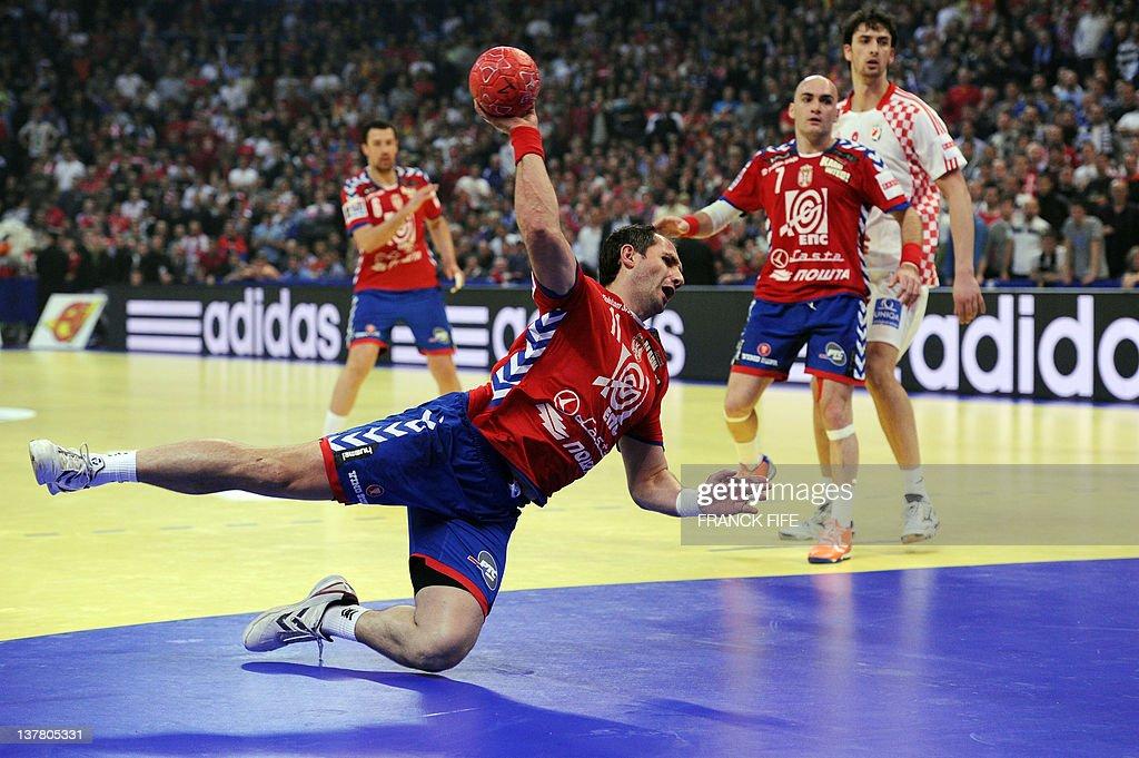 Serbia's Alem Toskic jumps to score during the men's EHF Euro 2012 Handball Championship semifinal match Serbia vs Croatia on January 27, 2012 at the Beogradska Arena in Belgrade.